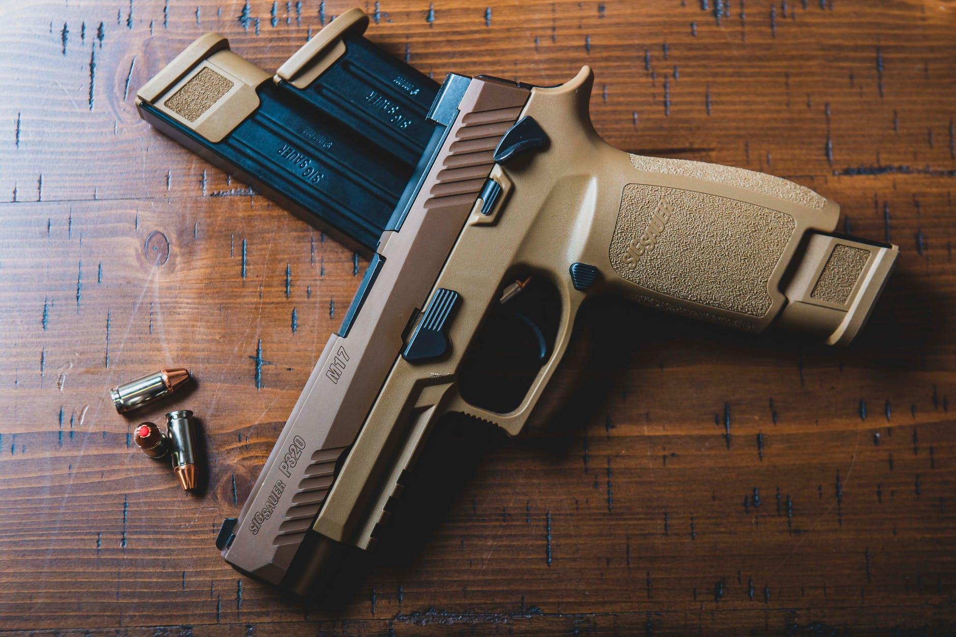 gray and black semi automatic pistol